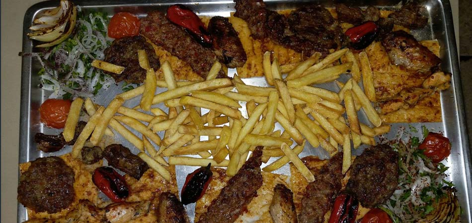 Mixed grill includes all sorts of meat and chcken with chips/fries