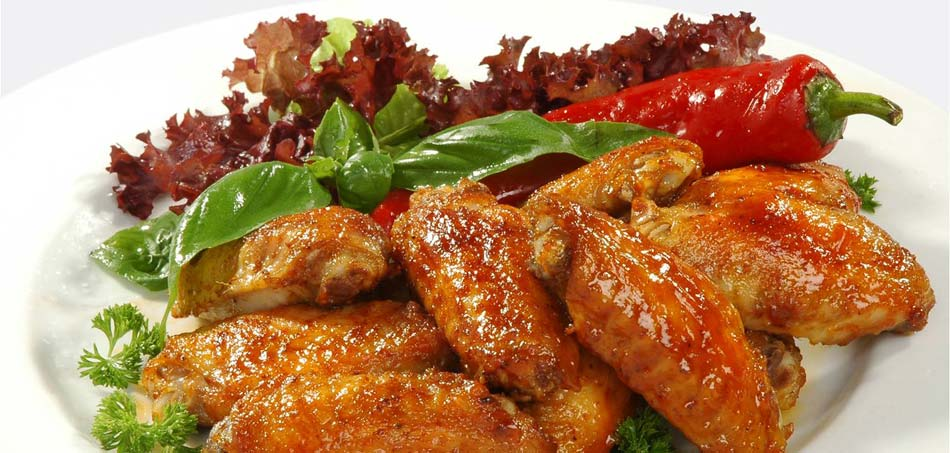 Chicken wings are delicious served with salad