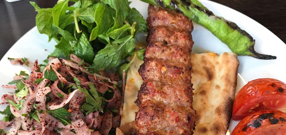 All the kebabs are served with roasted tomatoes and peppers, salads and flatbread