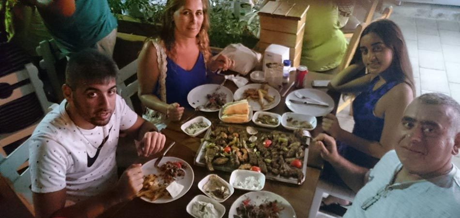 Friends share a huge plate of meat and kebabs