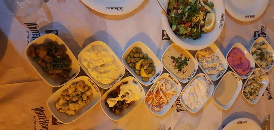 A wide spread of meze is served